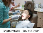 dentist is treating a boy's... | Shutterstock . vector #1024113934