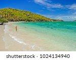 woman entering water on... | Shutterstock . vector #1024134940