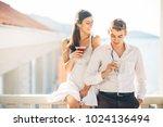 attractive couple drinking... | Shutterstock . vector #1024136494