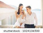 attractive couple drinking... | Shutterstock . vector #1024136500