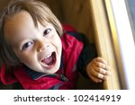 Cute Child With Toothy Smile...
