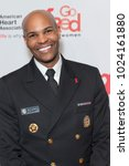 Small photo of New York, NY - February 8, 2018: US Surgeon General Dr. Jerome Adams attends show for Red Dress 2018 Collection Fashion Show at Hammerstein Ballroom
