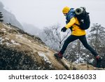 Man In Yellow Jacket Climbs Th...