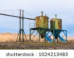 old rusty silos for food by the ... | Shutterstock . vector #1024213483