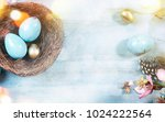 easter background with easter... | Shutterstock . vector #1024222564
