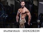 sexy strong bodybuilder... | Shutterstock . vector #1024228234