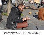 man portrait  man is sitting on ... | Shutterstock . vector #1024228333
