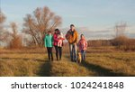 girls with parents walk in park ... | Shutterstock . vector #1024241848