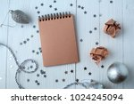 a notepad on a wooden table... | Shutterstock . vector #1024245094