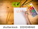 kids hand drawing a greeting on ... | Shutterstock . vector #1024248460