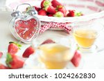 Fresh Strawberries On A White...