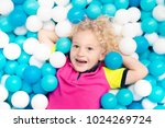 child playing in ball pit.... | Shutterstock . vector #1024269724