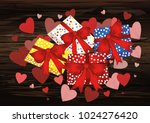 gift boxes  with a red bows and ...   Shutterstock .eps vector #1024276420