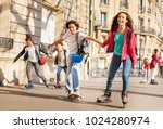 boys and girls rollerblading... | Shutterstock . vector #1024280974
