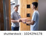 man receiving a package at home ... | Shutterstock . vector #1024296178