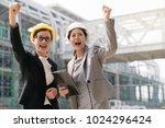 two asian female engineer raise ... | Shutterstock . vector #1024296424