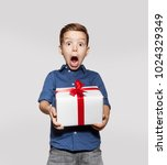 happy little boy with a gift ... | Shutterstock . vector #1024329349