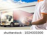 Shipper Hand Holding Smartphon...