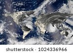 hurricane over the world map... | Shutterstock . vector #1024336966
