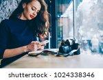 beautiful young woman chatting... | Shutterstock . vector #1024338346