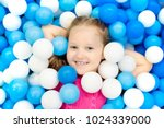 child playing in ball pit.... | Shutterstock . vector #1024339000