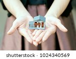 a model house model is placed... | Shutterstock . vector #1024340569