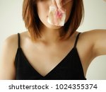young woman remove make up by... | Shutterstock . vector #1024355374
