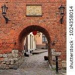 Small photo of Riga, Latvia - April 29, 2017: scenery arch passageway in old city of Riga, Latvia