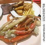 Small photo of Buffet Alaska crab legs With fried potato chips, grilled meat and fried chicken is a fast food. Bad for health and obesity.