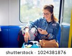 enjoying travel. young pretty... | Shutterstock . vector #1024381876