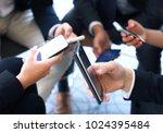 group of people using smart... | Shutterstock . vector #1024395484