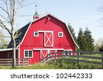 a bright red barn stands in the ... | Shutterstock . vector #102442333