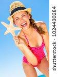 blue sea  white sand paradise.... | Shutterstock . vector #1024430284
