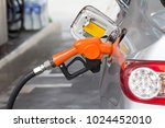fuel nozzle is filling oil to... | Shutterstock . vector #1024452010