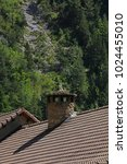 chimney on a roof in the... | Shutterstock . vector #1024455010