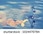a glass bottle with lamps... | Shutterstock . vector #1024470784