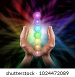 sending chakra healing energy   ... | Shutterstock . vector #1024472089