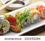 Sushi Assortment On White Dis...