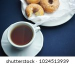 a cup of tea served with... | Shutterstock . vector #1024513939