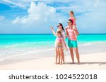 happy beautiful family of four... | Shutterstock . vector #1024522018