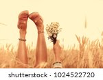 girl holding flowers and lying... | Shutterstock . vector #1024522720