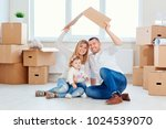 a happy family moves to a new... | Shutterstock . vector #1024539070