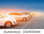 car parked row on road car a... | Shutterstock . vector #1024553344