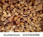 pile of firewood. preparation... | Shutterstock . vector #1024560088