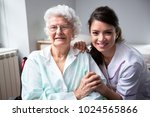 smiling nurse and old woman... | Shutterstock . vector #1024565866