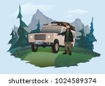 man driver stands next to the... | Shutterstock .eps vector #1024589374
