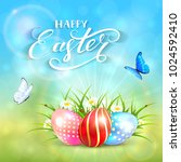 three colorful easter eggs with ...   Shutterstock .eps vector #1024592410