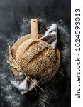 gold round loaf of rustic bread ... | Shutterstock . vector #1024593013