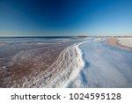 old breakwater on a sunny... | Shutterstock . vector #1024595128