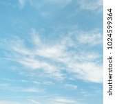 light cirrus clouds on blue sky ... | Shutterstock . vector #1024599364